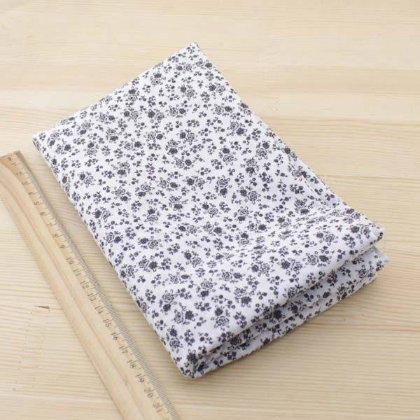 04 - tissu noir - collection Tacca - petites fleurs noires