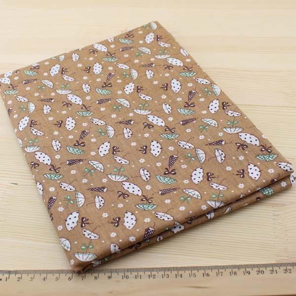 05 - collection Typha - tissu brun a motifs parapluies