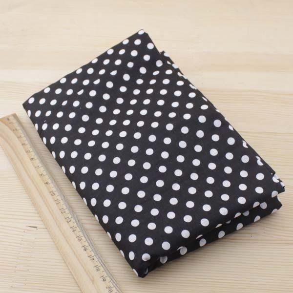 06 - tissu noir - collection Tacca - noir à pois blancs